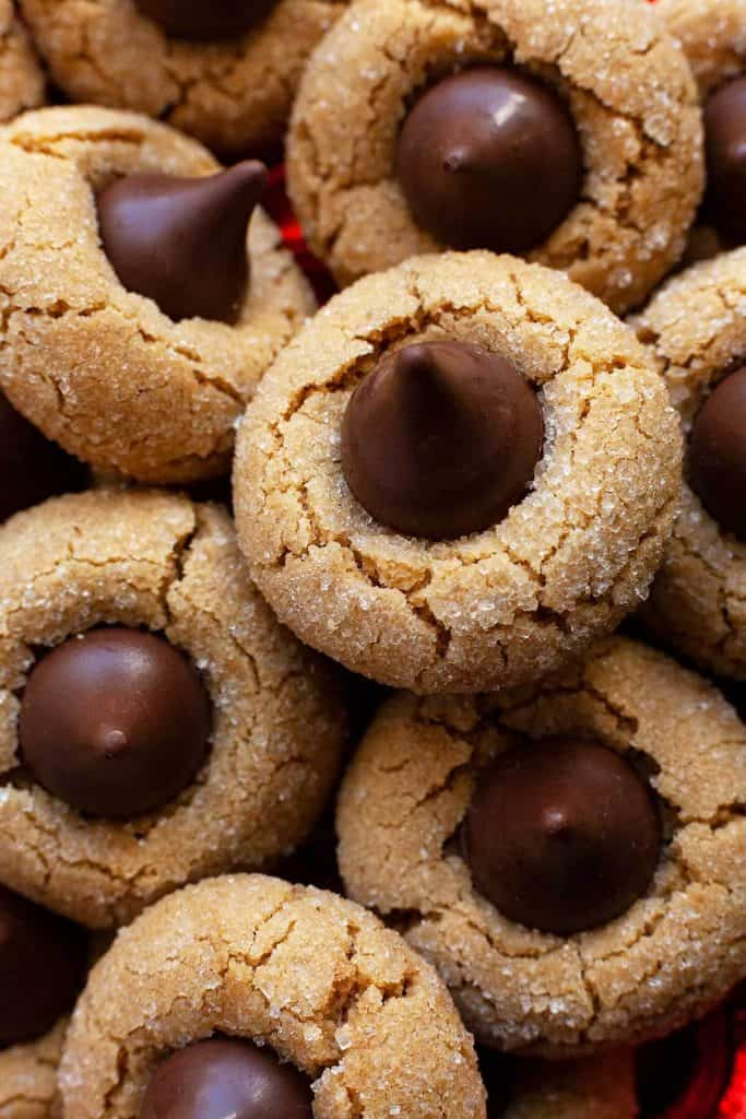 Peanut Butter Blossoms – soft and chewy peanut butter cookies topped with a chocolate kiss. Their sweet and salty combination is irresistible! #peanut butter blossoms #easy #from scratch #best #butter #peanut butter #cookies #holiday #christmas #without shortening #hersheys #soft #chewy #classic #original #perfect