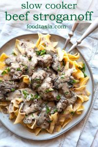 The most incredible Slow Cooker Beef Stroganoff you will ever have! Melt-in-your-mouth tender chunks of beef slowly simmered in a creamy mushroom sauce. As easy as it is delicious! A cozy, comforting meal the whole family will love. #beef #beefstroganoff #stroganoff #easy #crockpot #slowcooker #recipe #best #withstewmeat #traditional #creamy #videos #fromscratch #dinner #easydinner