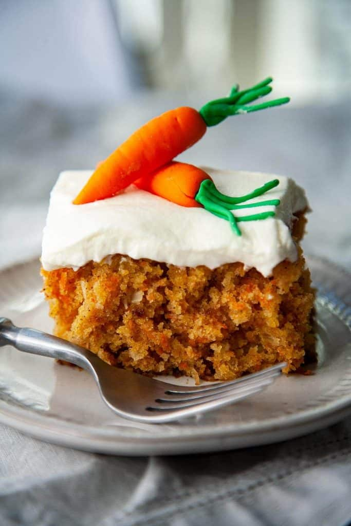 Incredibly moist and so delicious! This is my favorite Carrot Cake recipe – a super moist and tender Carrot Cake bursting with flavor from pineapple and coconut, topped with the most heavenly cream cheese frosting. #easy #best #recipe #healthy #homemade #cupcakes #decoration #pineapple #creamcheesefrosting #dessert #spring #easter