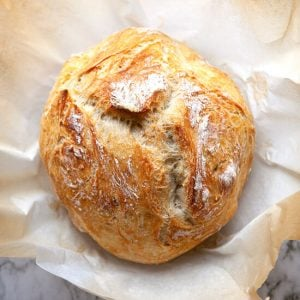 The world's easiest crusty, artisan No Knead Bread with a rustic crust and a soft chewy interior. Made in a dutch oven, with other options for baking. The most incredible No Knead Bread recipe.