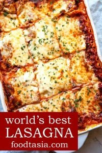 Classic Lasagna - layers of silky smooth, creamy parmesan béchamel sauce, a slow simmered Bolognese meat sauce, sheets of pasta, and lots of mozzarella cheese make this the World's Best Lasagna recipe.