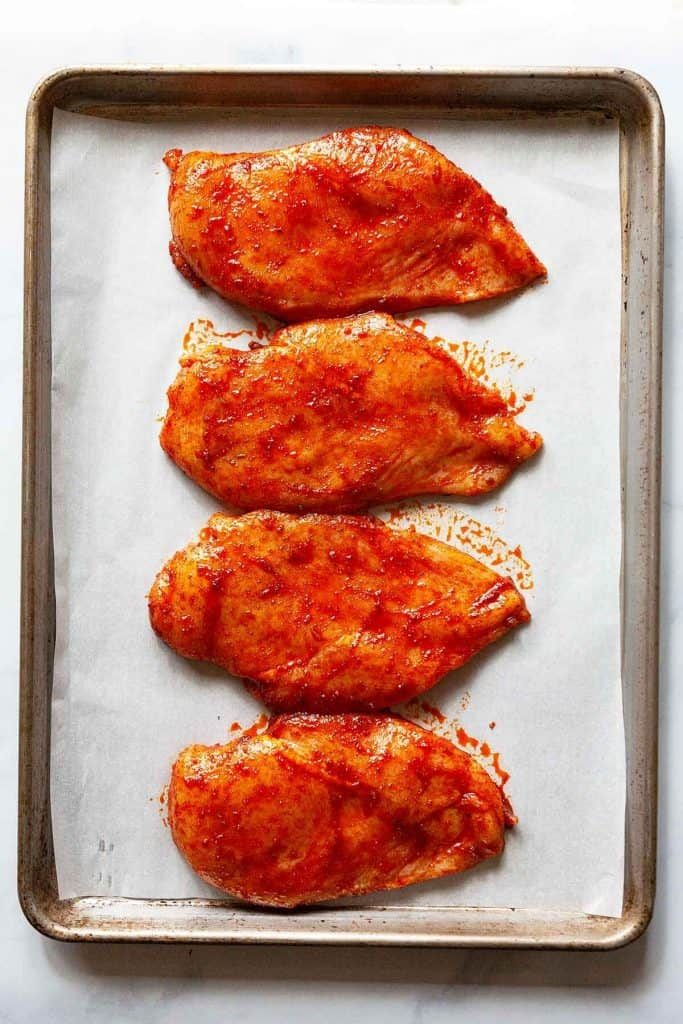 Baked Cajun Chicken Breasts are easy to cook and incredibly JUICY! Forget dry chicken with this tender, succulent oven baked chicken breast recipe!