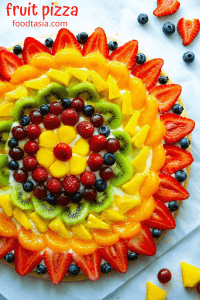 Fruit Pizza - The BEST summer dessert! With a soft sugar cookie crust, dreamy cream cheese frosting, and topped with fresh fruit. Super simple to make and always a hit!