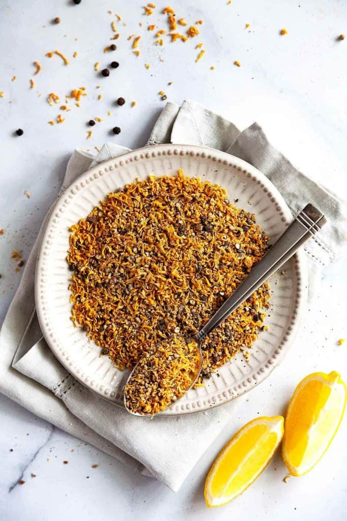 Easy Homemade Lemon Pepper Seasoning - with its bright citrus tang and its zingy peppery flavor - is my favorite seasoning for all things chicken and fish. So much better and cheaper than store bought.