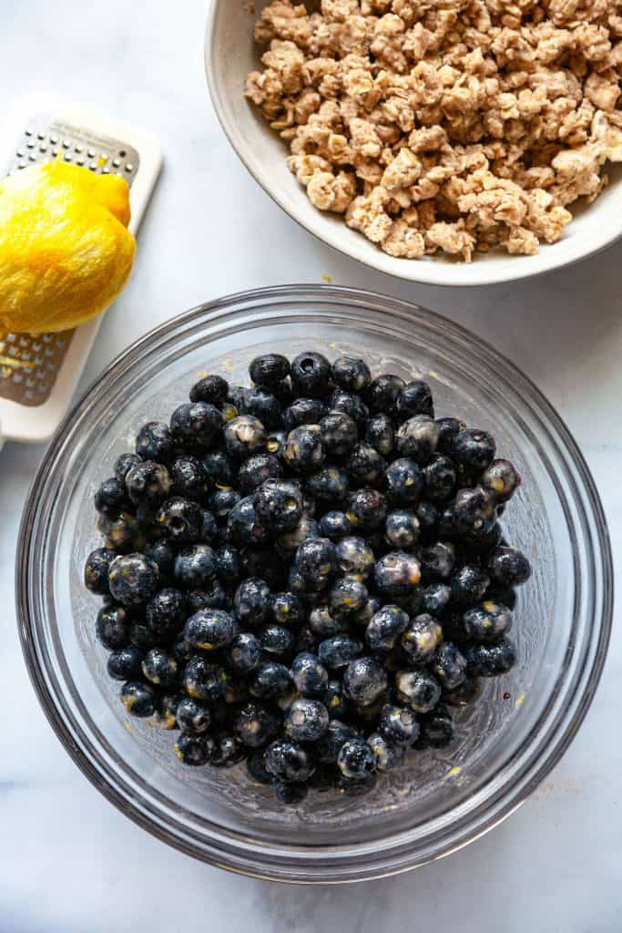 Quick and Easy Blueberry Crisp is bursting with sweet, juicy blueberries and a crunchy oat topping. This easy fruit crisp recipe is perfect served warm from the oven topped with a scoop of vanilla ice cream. The easiest dessert recipe EVER!