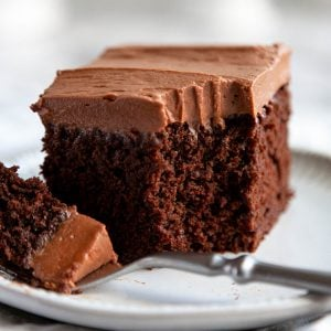 Chocolate Zucchini Cake - an incredibly moist chocolate cake topped with a cloud of chocolate cream cheese frosting. #dessert