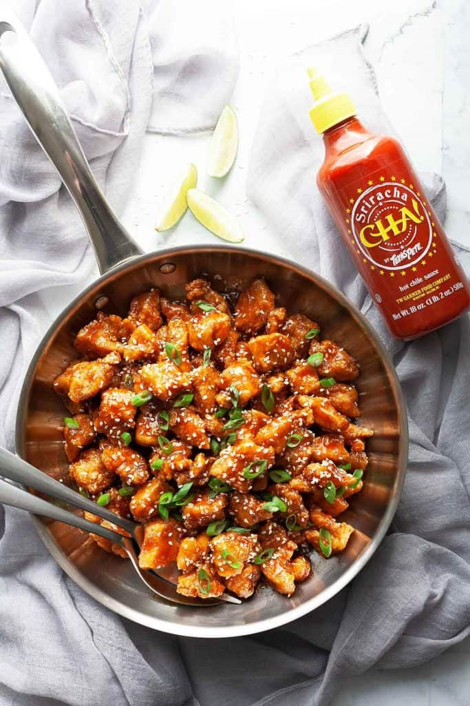 Honey Sriracha Chicken – little flavor bombs of light, crispy chunks of chicken in the most amazing tangy, sweet, and spicy Honey Sriracha Sauce. Quick and easy, you'll love this sweet and spicy chicken recipe that's big on flavor and ready in under 30 minutes!