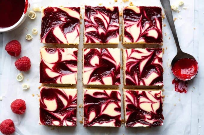 White Chocolate Raspberry Cheesecake Bars are lush and decadent with a rich and creamy, white chocolate cheesecake filling and a raspberry swirl. Super easy to make recipe and perfect for any occasion!