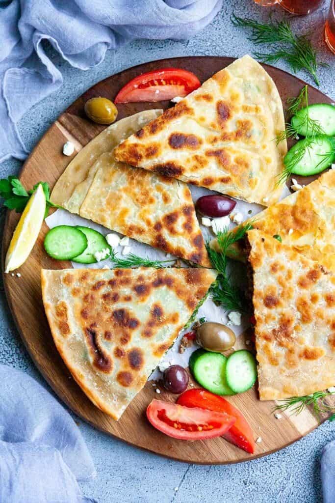 Turkish Gozleme Recipe– easy, homemade, Turkish flatbread stuffed with your choice of four fillings: spicy lamb or beef, spinach and feta, cheese and herb, and potato and cheese. An easy to make recipe without yeast!