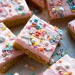 The BEST thick and chewy Sugar Cookie Bars with vanilla buttercream frosting. Quick and easy to make bar cookies recipe! #dessert #homemade #fromscratch