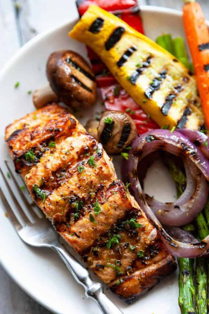 grilled salmon on a plate with grilled vegetables