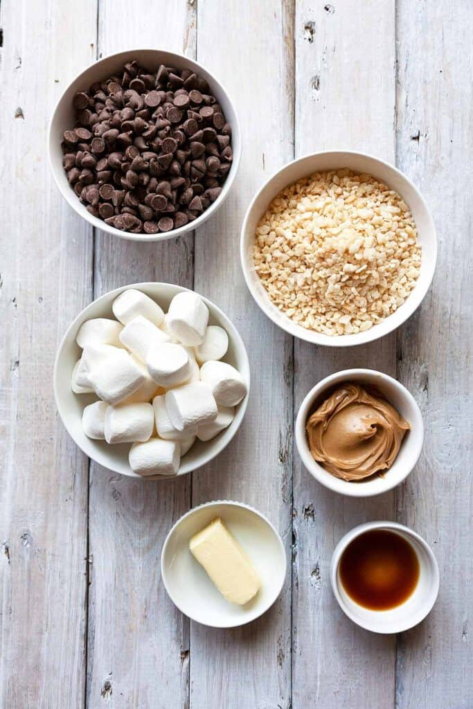 ingredients for rice krispie treats: marshmallows, peanut butter, rice krispies, chocolate chips, butter, vanilla