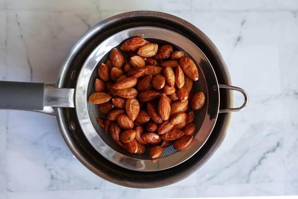 draining boiled almonds