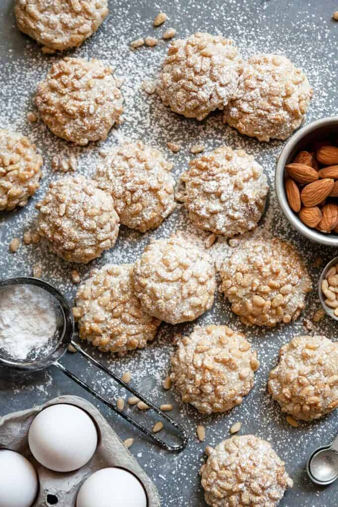 Italian Pignoli Cookies with a sugar sifter and almonds