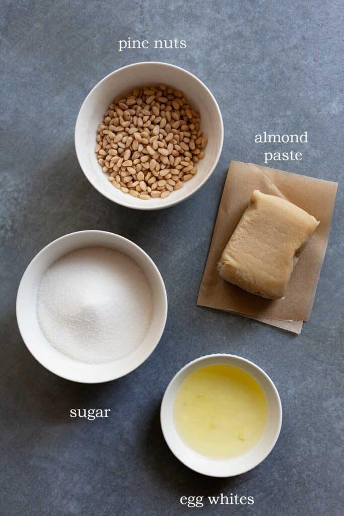 ingredients for Italian Pignoli Cookies: pine nuts, sugar, almond paste, egg wihites