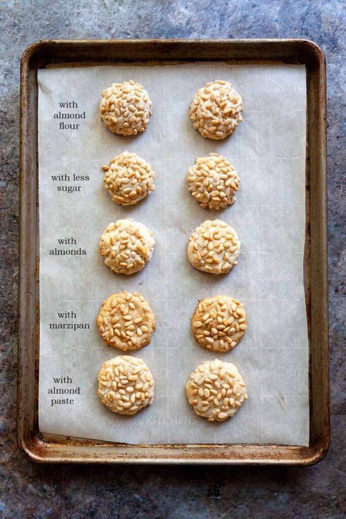 cookie sheet showing 5 different variations of pignoli cookie recipe