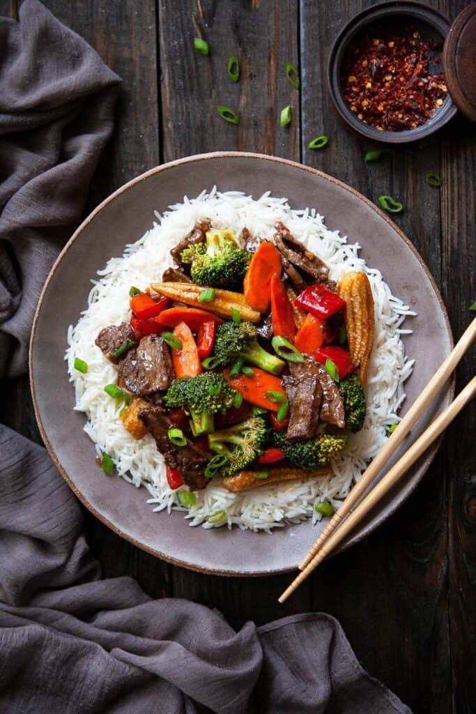 Hunan beef on a plate of rice