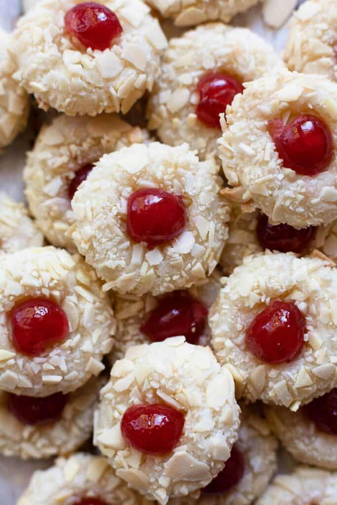 almond macaroons with cherries on top