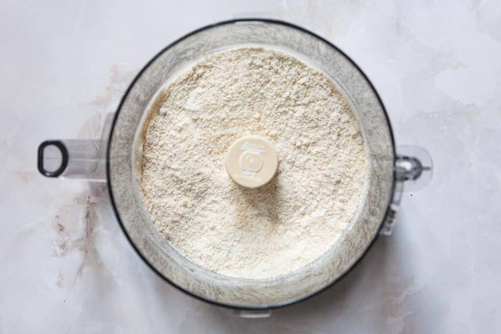 how to make almond paste step by step: finely ground almonds and sugar
